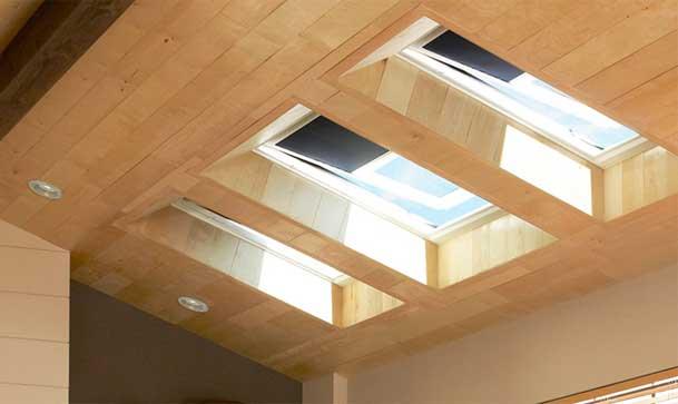 Installed Velux residential venting skylights in den